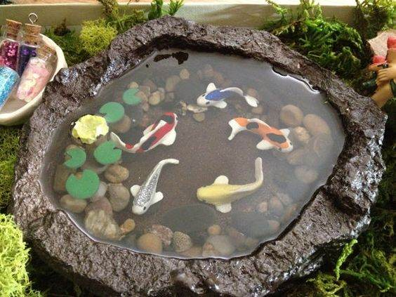 Fairy garden koi pond gardening flowers 101 gardening for Koi pool water gardens cleveleys
