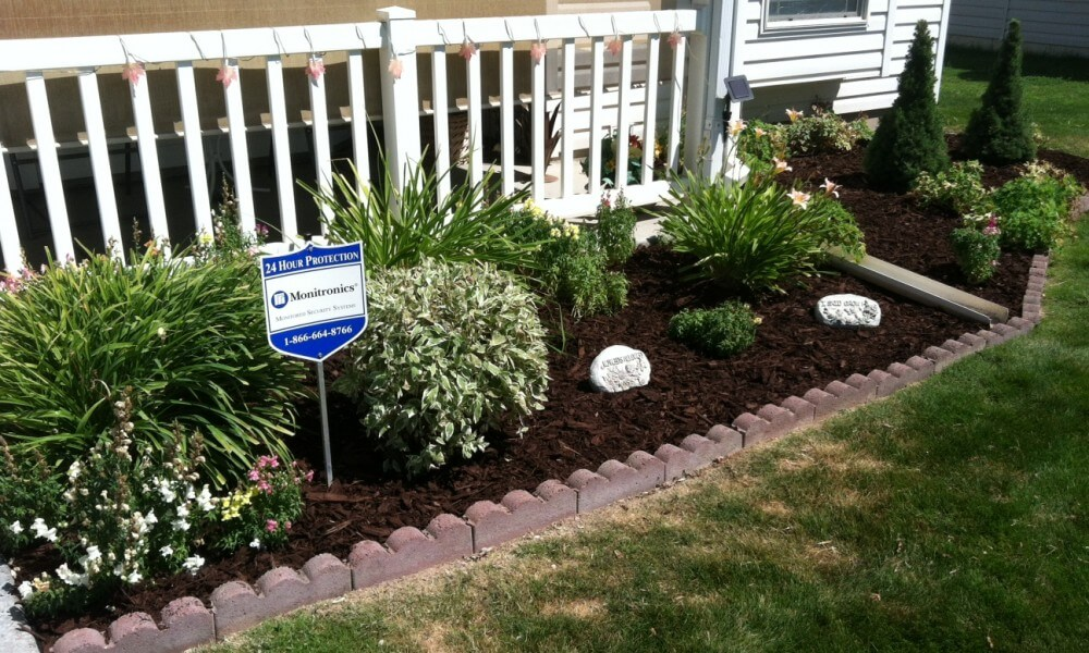 Flower bed ideas for front of house gardening flowers for Landscaping rocks visalia ca